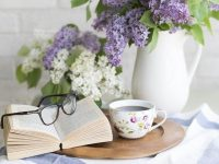 Books, floral tea cup and glasses